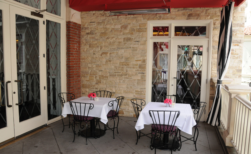 Restaurant patio with custom powder-coated ceiling mounted W-Series heaters.