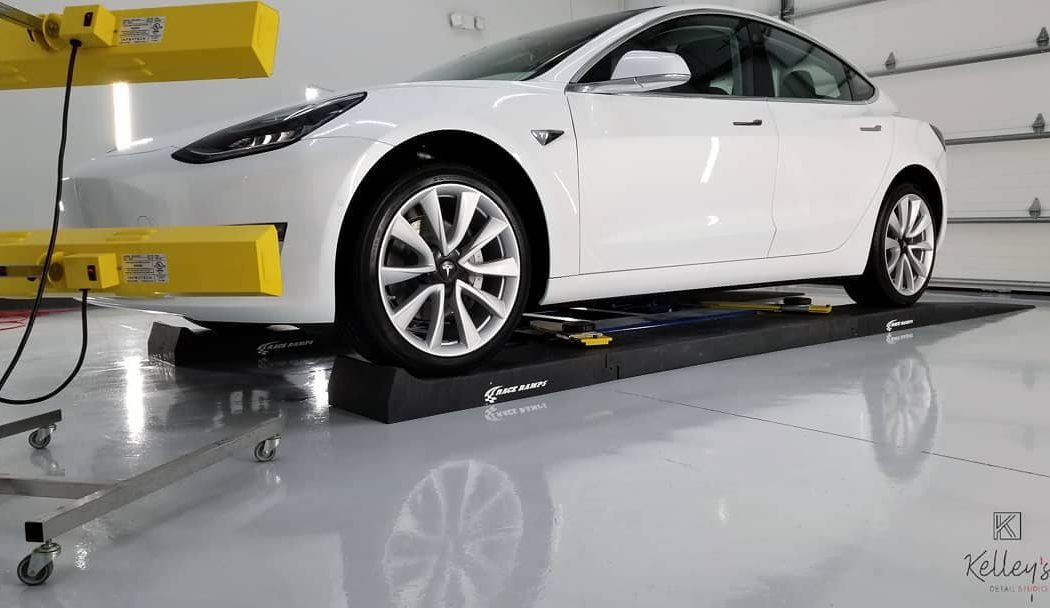 This 2018 Tesla Model 3 gets a full correction with one of our curing lamps.