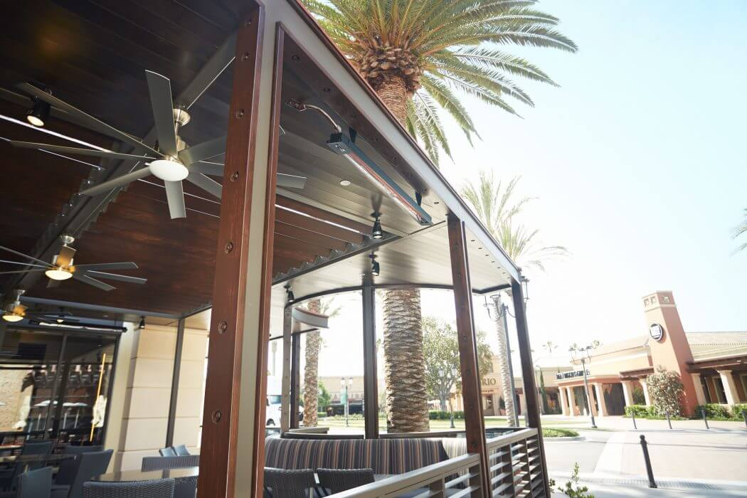 Slimline Infratech heaters installed to the ceiling of restaurant outdoor seating space.