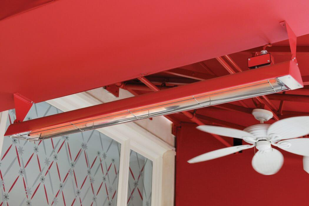 American Girl Place restaurant patio installed custom powder-coated red ceiling mounted W-Series heaters.