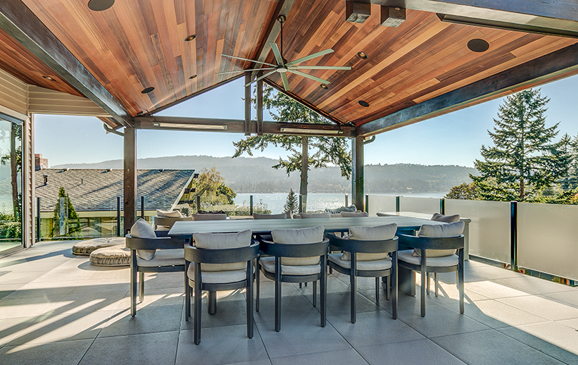 Outdoor entertainment space with wall mount SL-Series heaters. Photo via Mike Byron.