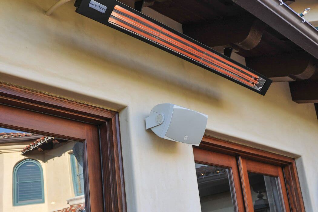Slimline heater wall mounted below roof to blend into the architecture and provide ample outdoor heat.