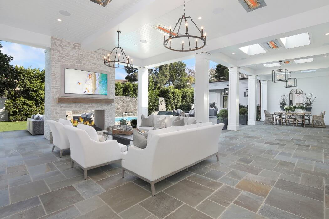 Flush mounted heaters blend into the white clean design of this indoor/ outdoor patio.