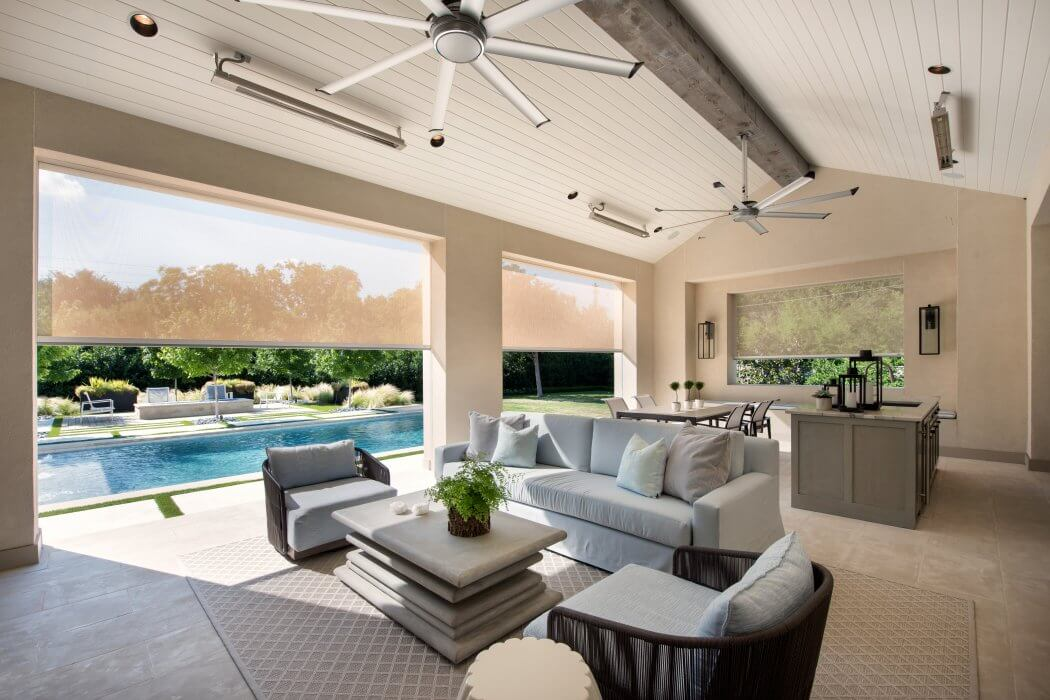 Three Slimline heaters specified in this stunning poolside living room.