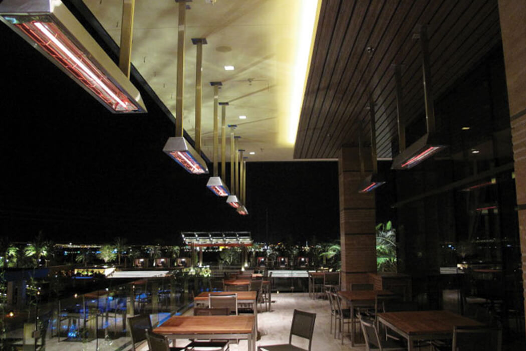 Restaurant patio in Las Vegas features custom W-Series heaters mounted in custom metal shrouds.