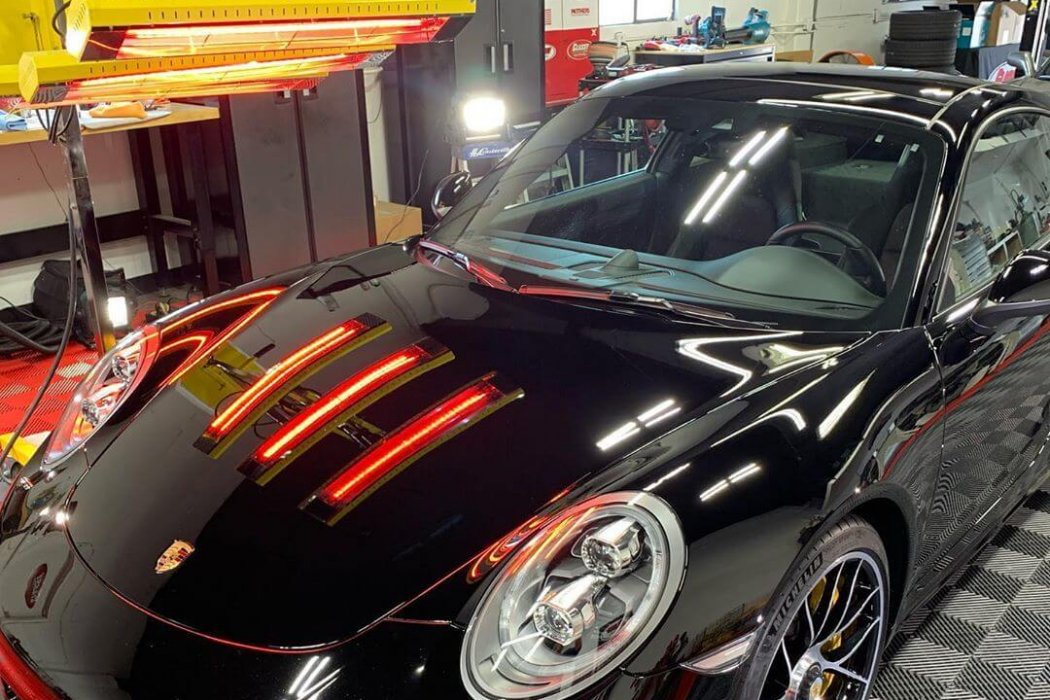 This sleek, black Porsche receives the finest paint protection using our Model SR-6000 short wave system.