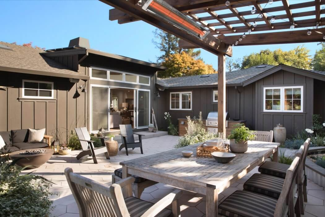 Transitional backyard patio in San Francisco utilize a decorated pergola to mount Infratech's WD-Series heater.
